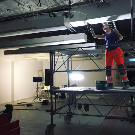 Veera painting the ceiling of our new studio.